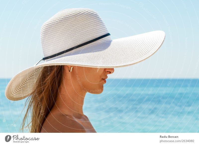 Young Woman Portrait With White Beach Hat Lifestyle Elegant Style Joy Beautiful Relaxation Leisure and hobbies Vacation & Travel Freedom Summer Summer vacation
