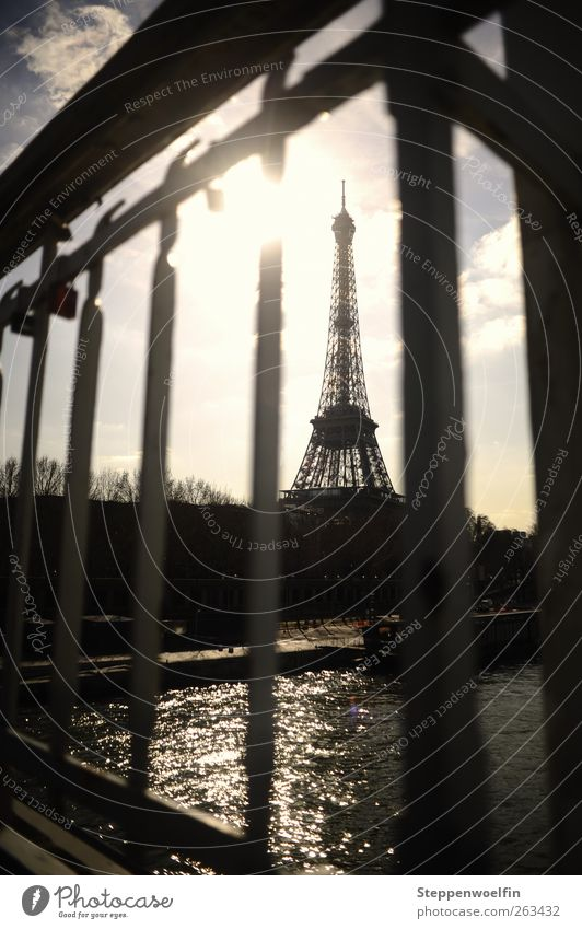 Eiffel Tower behind bars Paris France Europe Town Capital city Downtown Skyline Deserted Bridge Tourist Attraction Landmark Steel Rust To enjoy Blue Gray Art