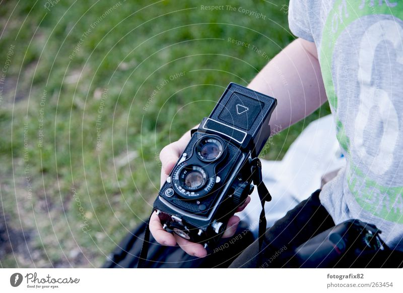 binocular Lifestyle Camera Technology Masculine Young man Youth (Young adults) Arm Hand 1 Human being 18 - 30 years Adults Summer Meadow To hold on Retro Blue