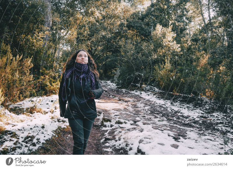 Girl fooling around on a snowy mountain road in winter Design Joy Happy Beautiful Vacation & Travel Trip Adventure Winter Snow Mountain Woman Adults Environment