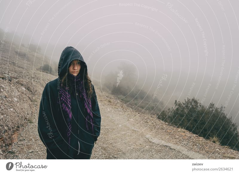 Girl with hood in a mountain landscape with a lot of fog Lifestyle Beautiful Vacation & Travel Tourism Trip Adventure Winter Hiking Human being Woman Adults