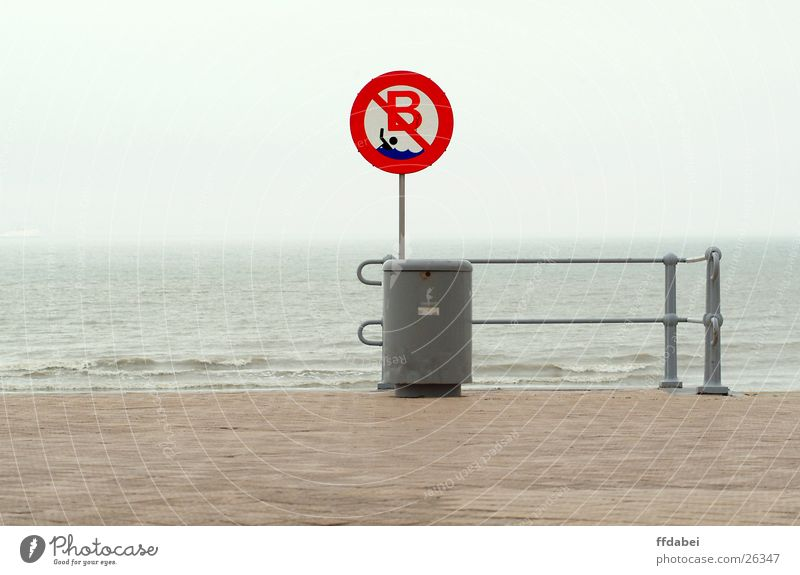 bathing prohibited Beach Ocean Bans Wastepaper basket Bad weather Belgium Gray Dreary Red Nature Landscape Water North Sea Signs and labeling Swimming & Bathing