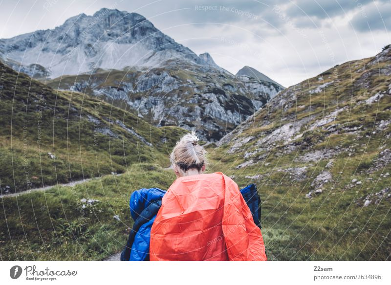 Young woman crossing the Alps Vacation & Travel Adventure Hiking Youth (Young adults) 18 - 30 years Adults Nature Landscape Autumn Mountain Peak Backpack