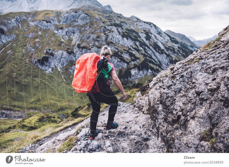Nature Vacation & Travel Youth (Young adults) Young woman Loneliness Mountain Adults Rock Hiking Blonde Adventure Beautiful weather Peak Alps Athletic Brave