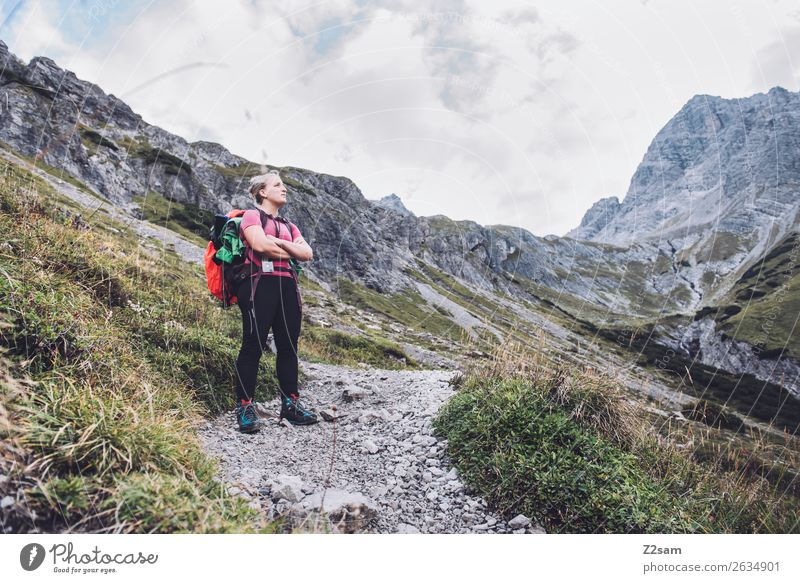 Young woman crossing the Alps Leisure and hobbies Vacation & Travel Adventure Hiking Youth (Young adults) 18 - 30 years Adults Nature Landscape Rock Mountain