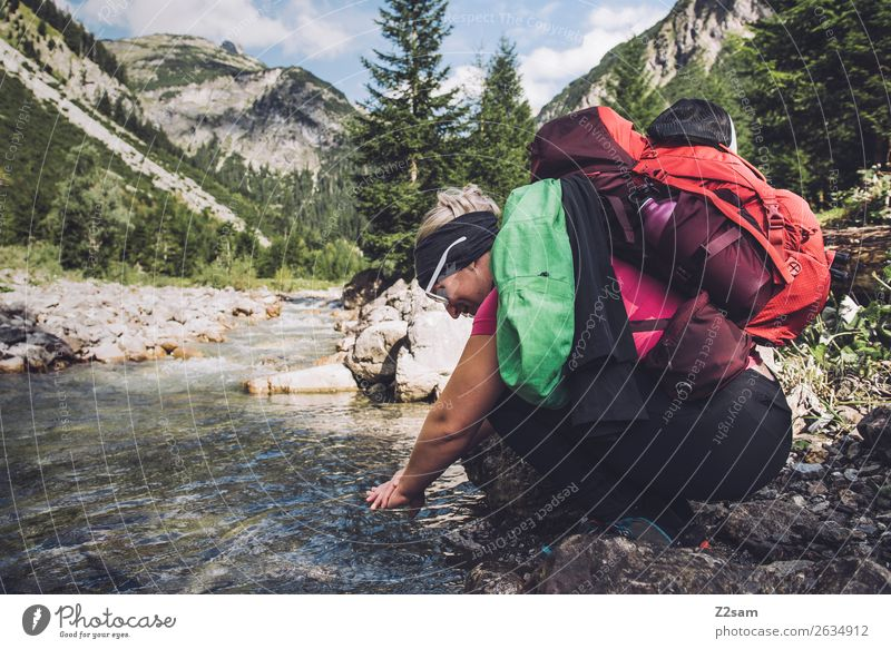 Young woman refreshes herself while hiking Vacation & Travel Adventure Hiking Youth (Young adults) 18 - 30 years Adults Nature Landscape Beautiful weather