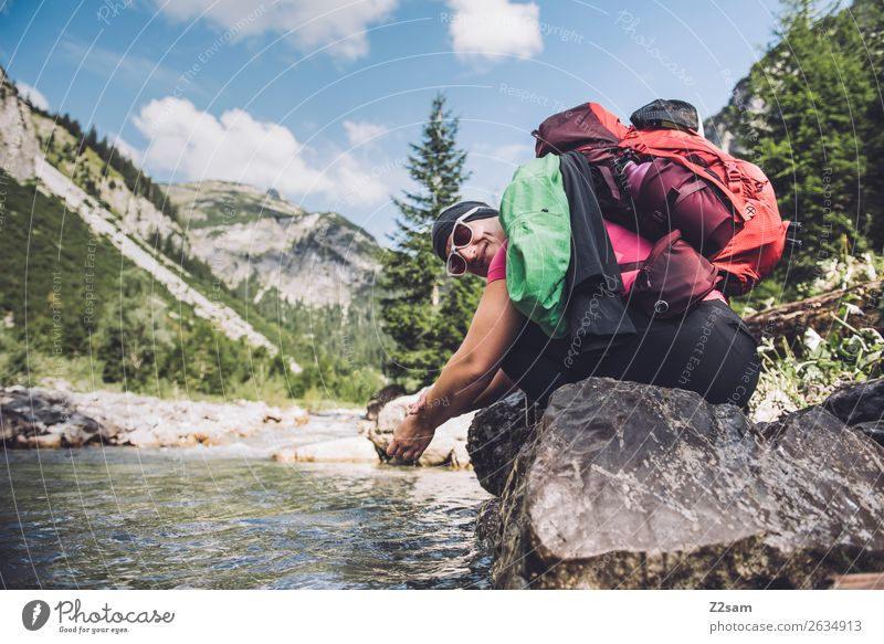 Woman refreshes herself while hiking Vacation & Travel Adventure Hiking Young woman Youth (Young adults) 18 - 30 years Adults Nature Landscape Summer