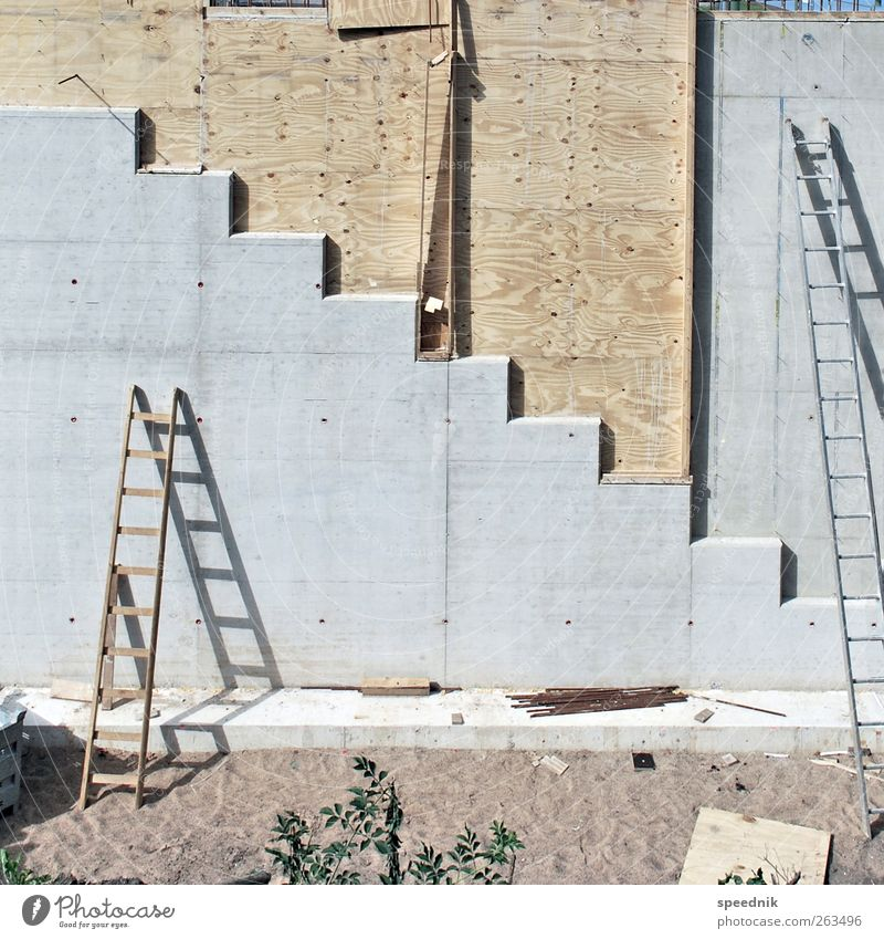 Concrete, wood and ladders Manmade structures Architecture Wall (barrier) Wall (building) Stairs Facade Ladder Wood Sharp-edged Simple Large Tall Brown Gray