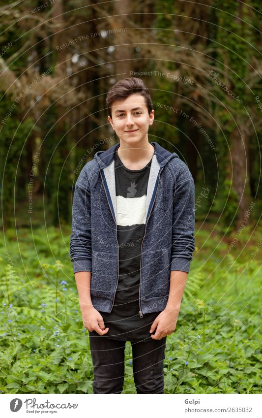 Attractive teenager guy in a park Lifestyle Style Happy Beautiful Hair and hairstyles Face Summer Human being Boy (child) Man Adults Youth (Young adults) Nature