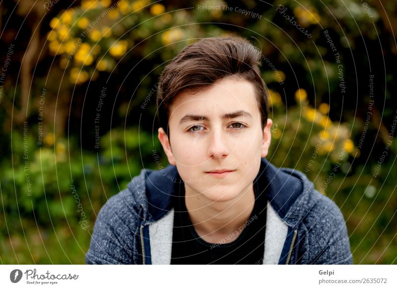 Attractive teenager guy in a park with green plant Lifestyle Style Happy Beautiful Hair and hairstyles Face Summer Human being Boy (child) Man Adults