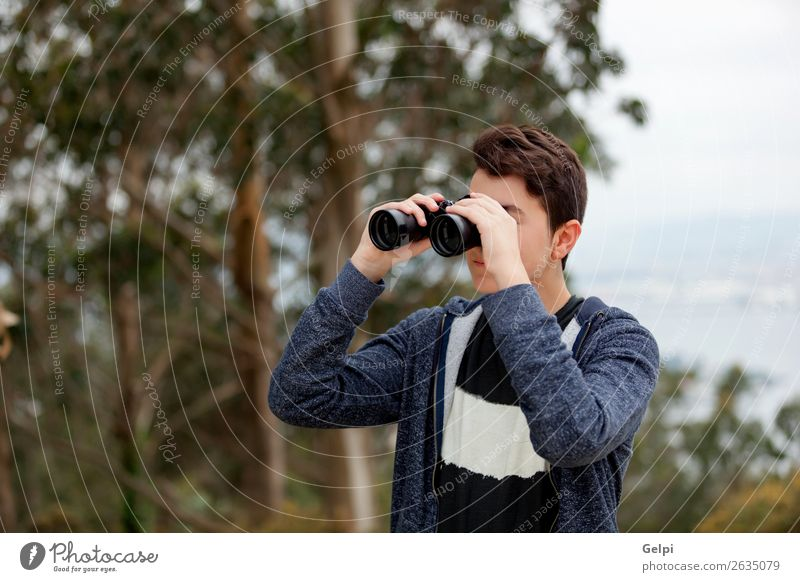 Teenager guy looking with binoculars Child Human being Youth (Young adults) Man Summer White Hand Tree Joy Lifestyle Adults Emotions Happy Boy (child) Small