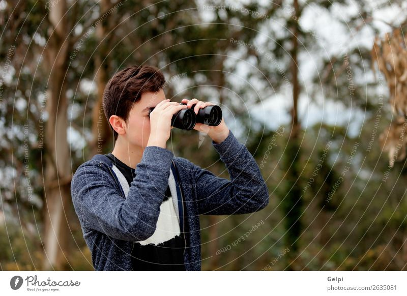 Teenager guy looking with binoculars Lifestyle Joy Happy Leisure and hobbies Summer Child Human being Boy (child) Man Adults Infancy Youth (Young adults) Hand