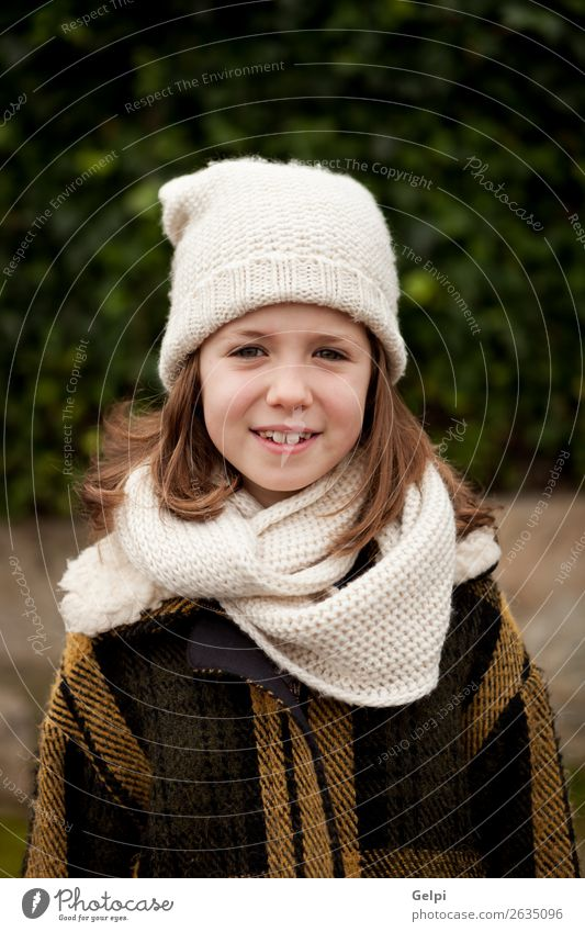 Pretty girl with wool hat in a park Woman Child Human being Nature Beautiful White Joy Winter Face Adults Warmth Autumn Funny Family & Relations Happy Small