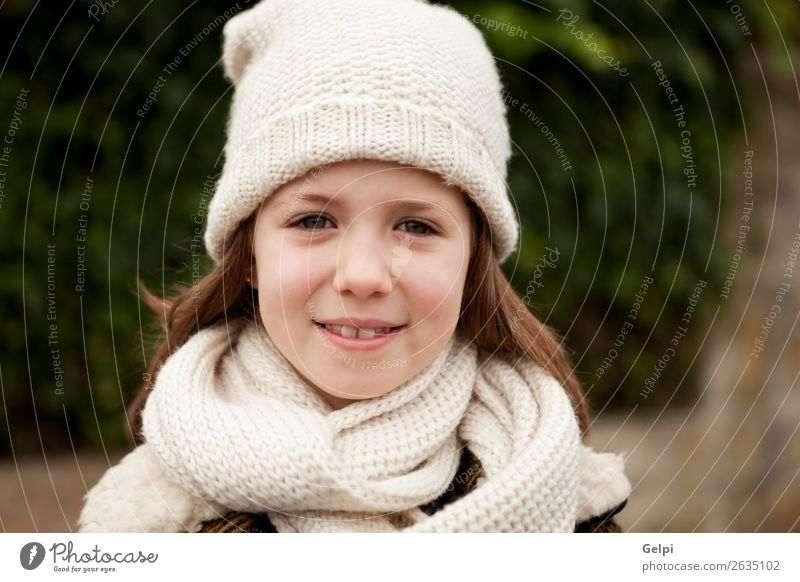 Pretty girl with wool hat in a park Joy Happy Beautiful Face Winter Garden Child Human being Toddler Woman Adults Family & Relations Infancy Nature Autumn