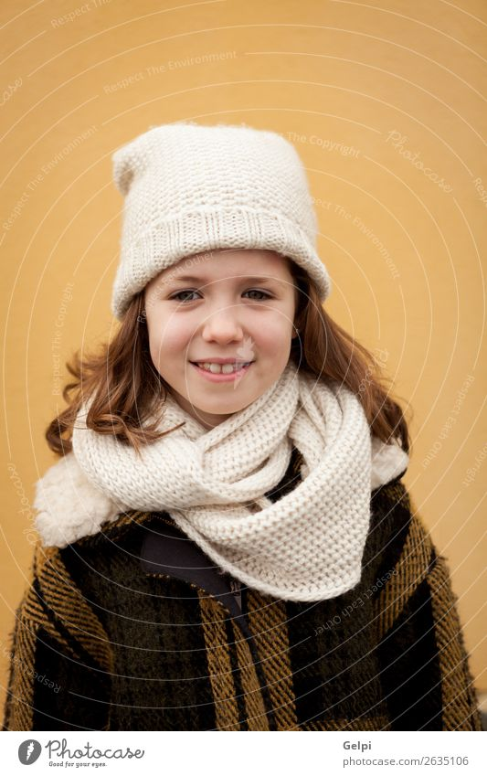 Pretty little girl in the street Woman Child Human being Beautiful White Joy Winter Face Street Adults Warmth Autumn Yellow Funny Family & Relations Happy