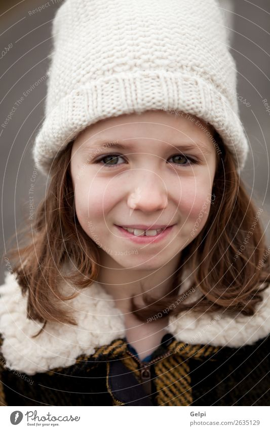 Beautiful girl with wool hat at winter Woman Child Human being White Joy Winter Face Street Adults Warmth Autumn Funny Family & Relations Happy Small
