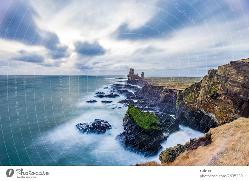 Lóndrangar rock formation Iceland Londrangar Exterior shot Colour photo Brown Nature Ocean Long exposure Coast Landscape Sky Clouds Rock Water Wild Beach