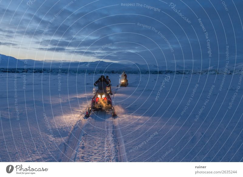 Snowmobile tour at dusk snowmobile Spitzbergen Tourism Mountain Landscape Norway The Arctic Exterior shot Scandinavia North Winter polar Cold Vacation & Travel