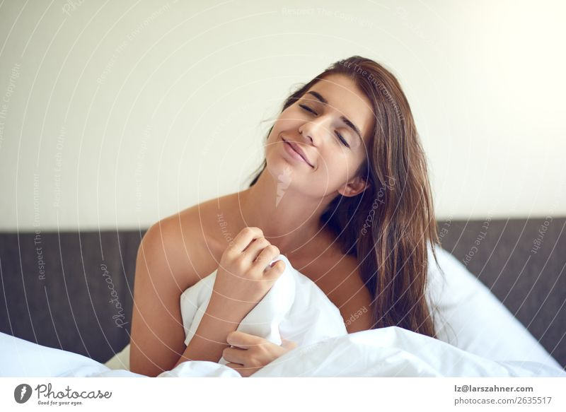 Young woman sitting in bed and smiling Happy Beautiful Relaxation Bedroom Woman Adults 1 Human being 18 - 30 years Youth (Young adults) Brunette Smiling Sleep