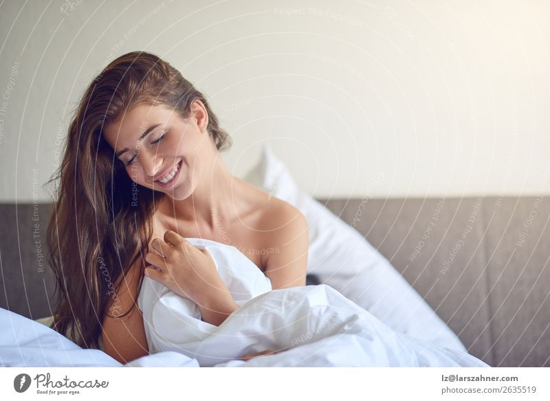 Young woman sitting in bed and smiling Woman Human being Youth (Young adults) Beautiful Green Eroticism Relaxation 18 - 30 years Adults Happy Copy Space Smiling