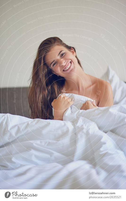 Beautiful girl sitting in bed in white linens Woman Human being Youth (Young adults) Green Eroticism Relaxation 18 - 30 years Adults Happy Copy Space Smiling
