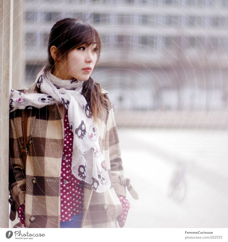 Human being Woman Youth (Young adults) Winter Adults Wall (building) Wall (barrier) Sadness Think Leisure and hobbies Wait Young woman Stand 18 - 30 years Meditative University & College student