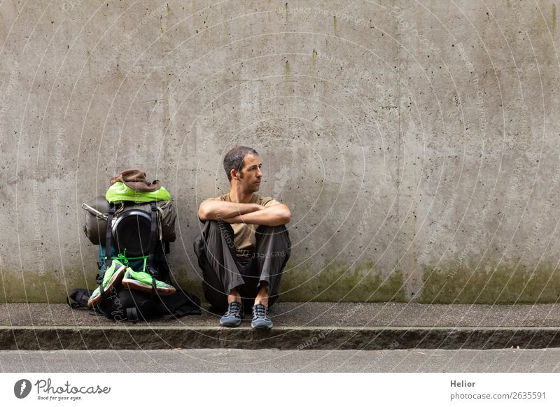 Backpacker takes a break from travelling by hitchhiker Lifestyle Vacation & Travel Trip Adventure Far-off places Freedom Human being Man Adults 30 - 45 years