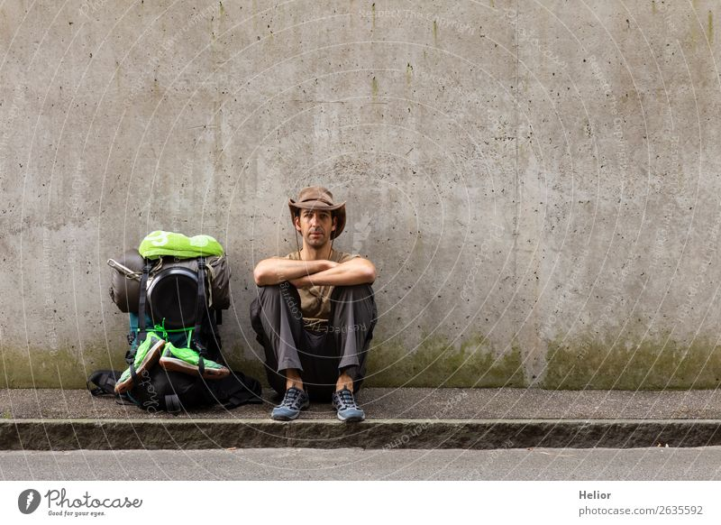 Backpacker takes a break from travelling by hitchhiker Lifestyle Vacation & Travel Tourism Trip Adventure Far-off places Freedom City trip Human being Man