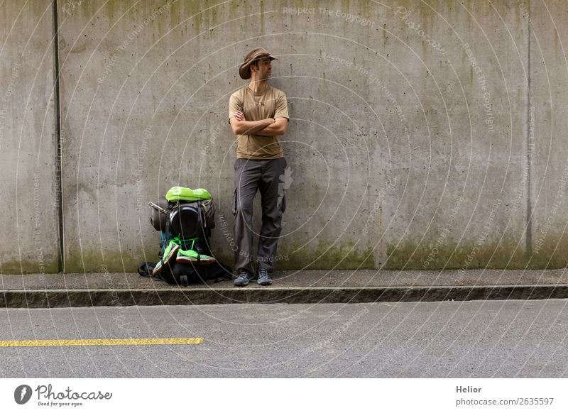 Backpacker takes a break from travelling by hitchhiker Lifestyle Vacation & Travel Tourism Trip Adventure Far-off places Freedom Human being Man Adults