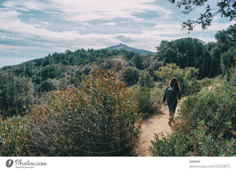 Woman walking in the distance on a trail among mountains on a sunny day Lifestyle Joy Happy Leisure and hobbies Vacation & Travel Tourism Adventure Freedom