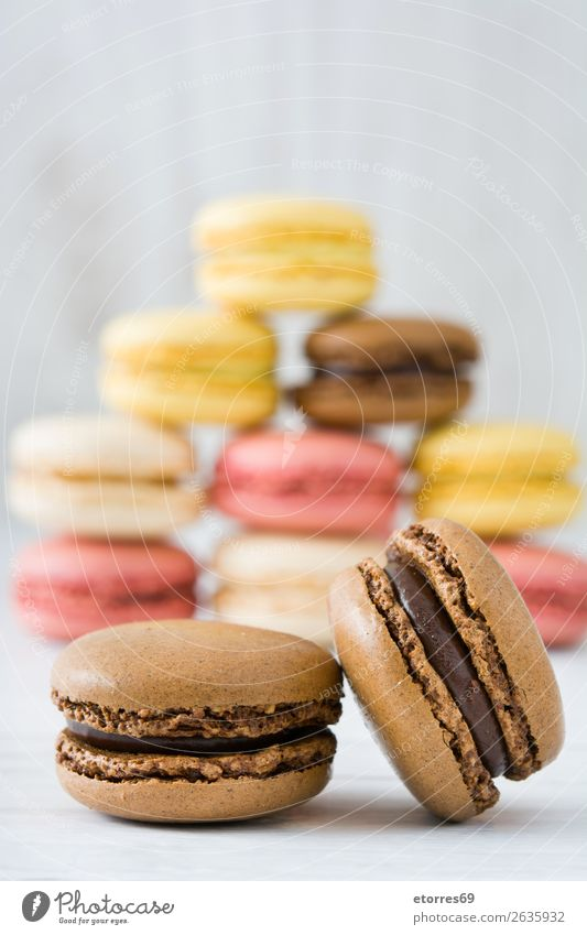 Colorful macarons on white wooden table Macaron Strawberry Lemon Dessert Coffee Yellow Chocolate Confectionary Raspberry Tradition Candy cut out cookies Tasty