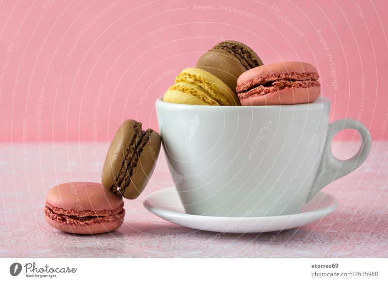 Colorful macarons in a cup on pink background Macaron Strawberry Lemon Dessert Coffee Yellow Chocolate Confectionary Raspberry Tradition Candy cut out cookies
