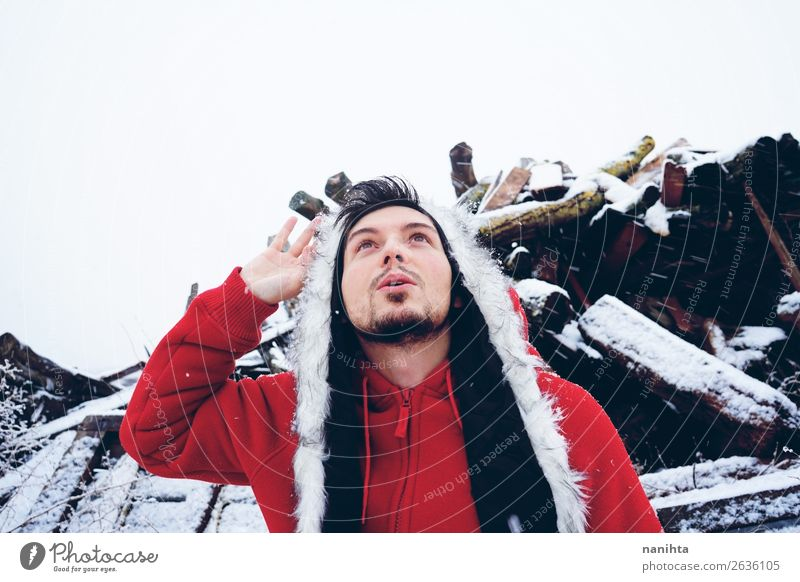 Young and attractive man enjoying a snowy winter day Human being Nature Youth (Young adults) Man Young man White Red Joy Winter Lifestyle Adults Natural Funny