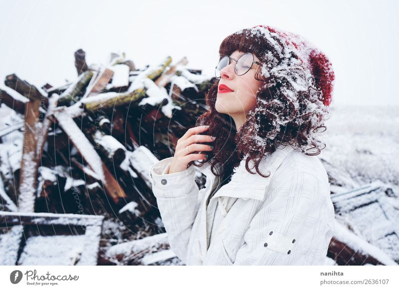 Young woman enjoying a snowy winter day Woman Human being Nature Youth (Young adults) Christmas & Advent White Loneliness Joy Winter 18 - 30 years Healthy Face