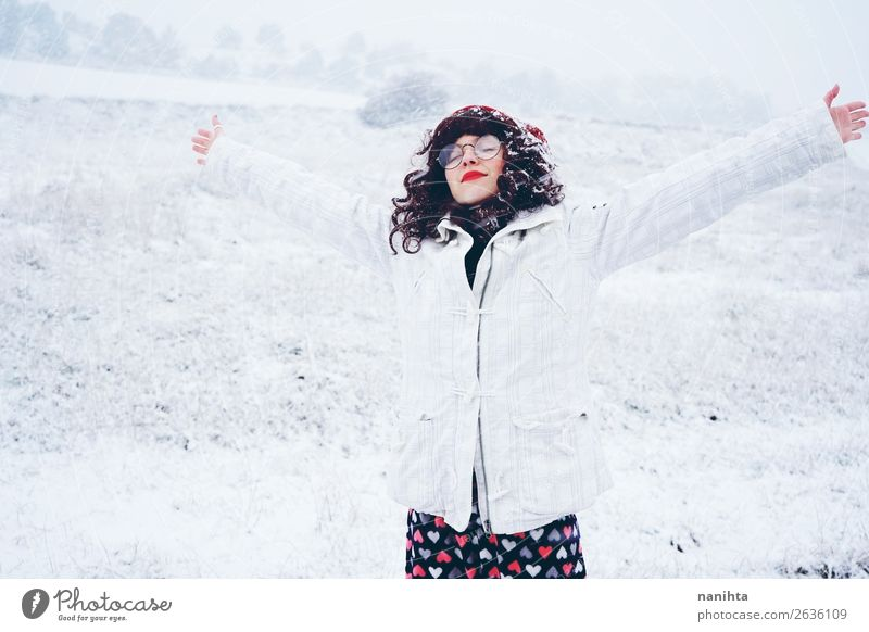 Young and pretty woman enjoying a snowy winter day Woman Human being Nature Youth (Young adults) Christmas & Advent Young woman White Loneliness Joy Winter