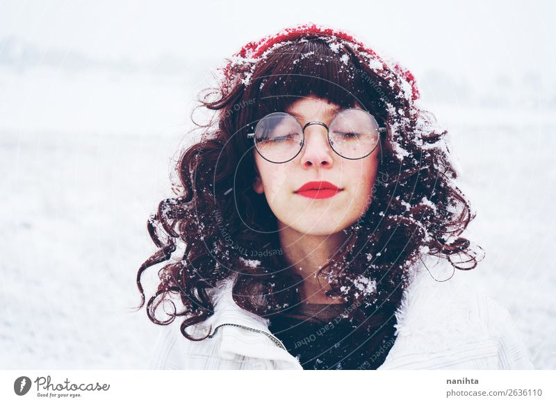 Young and pretty woman enjoying a snowy winter day Woman Human being Nature Youth (Young adults) Christmas & Advent Young woman White Loneliness Calm Winter