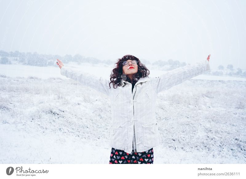 Young and pretty woman enjoying a snowy winter day Lifestyle Style Happy Face Leisure and hobbies Adventure Freedom Winter Snow Winter vacation