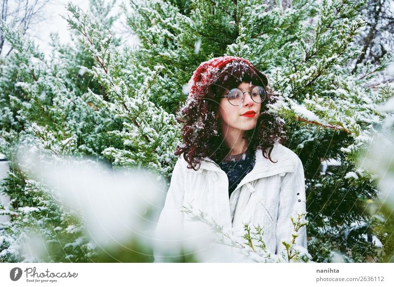 Young woman enjoying a snowy winter Woman Human being Nature Youth (Young adults) Christmas & Advent Beautiful Green Tree Joy Forest Winter 18 - 30 years