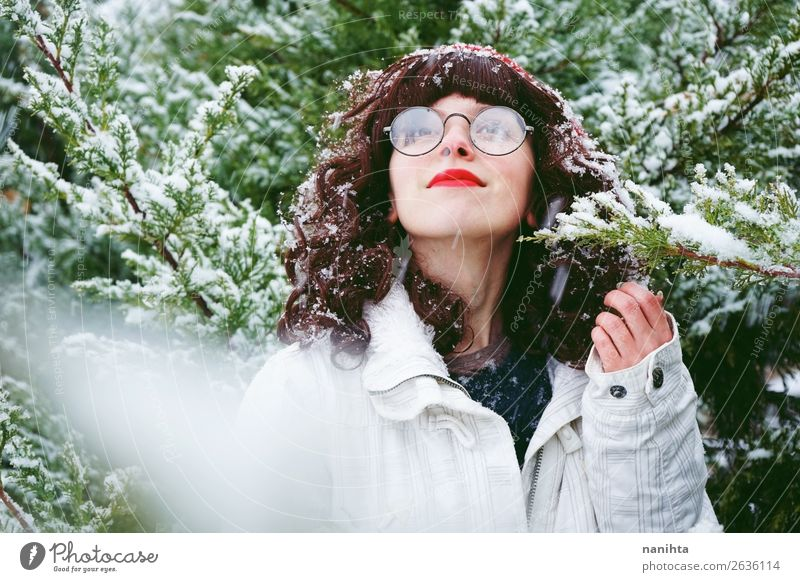 Young woman enjoying a snowy winter day Woman Human being Nature Youth (Young adults) Christmas & Advent Green Tree Joy Forest Winter 18 - 30 years Healthy