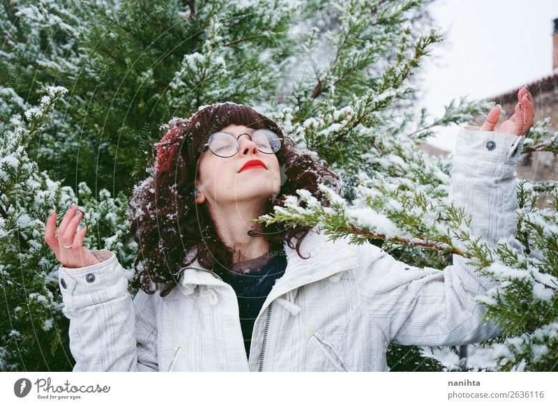 Young woman enjoying a snowy winter day Woman Human being Nature Youth (Young adults) Christmas & Advent Green White Tree Joy Forest Winter Healthy