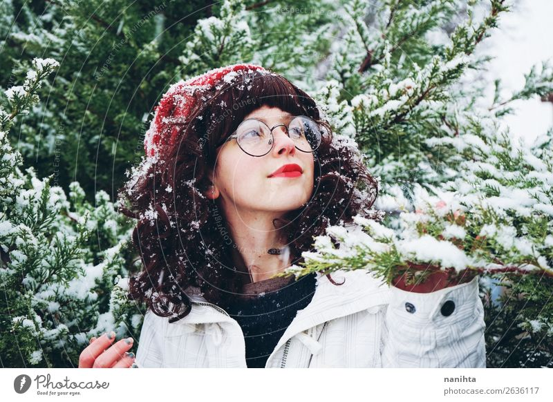 Young woman enjoying a snowy winter day Woman Human being Nature Youth (Young adults) Christmas & Advent Tree Forest Winter 18 - 30 years Lifestyle Adults