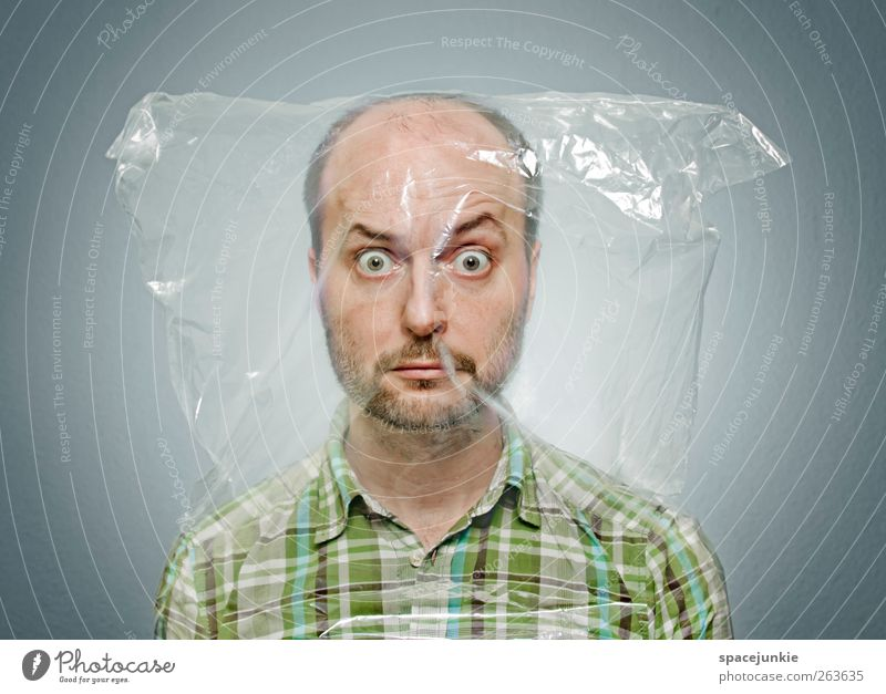 Packed Human being Masculine 1 30 - 45 years Adults Observe Creepy Green Plastic bag Whimsical Looking Humor Funny Breathlessness Asphyxiate Enclosed Crazy