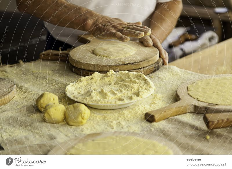Kneading dough in a traditional bakery Dough Baked goods Bread Eating Table Kitchen Restaurant Work and employment Human being Woman Adults Man Hand Wood Make