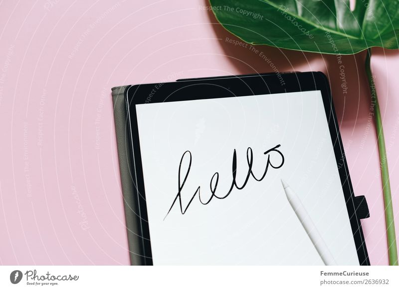 "Tablet with a handwritten ""hello"" on pink background Technology Entertainment electronics Advancement Future Stationery Paper Creativity Salutation Handwriting"