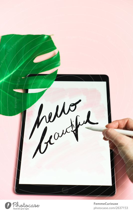 "Tablet with a handwritten ""hello beautiful"" on pink background Lifestyle Technology Entertainment electronics Advancement Future Stationery Paper Communicate"