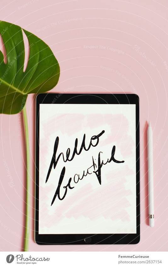 "Tablet with a handwritten ""hello beautiful!"" on pink background Technology Entertainment electronics Advancement Future Nature Communicate Handwriting"