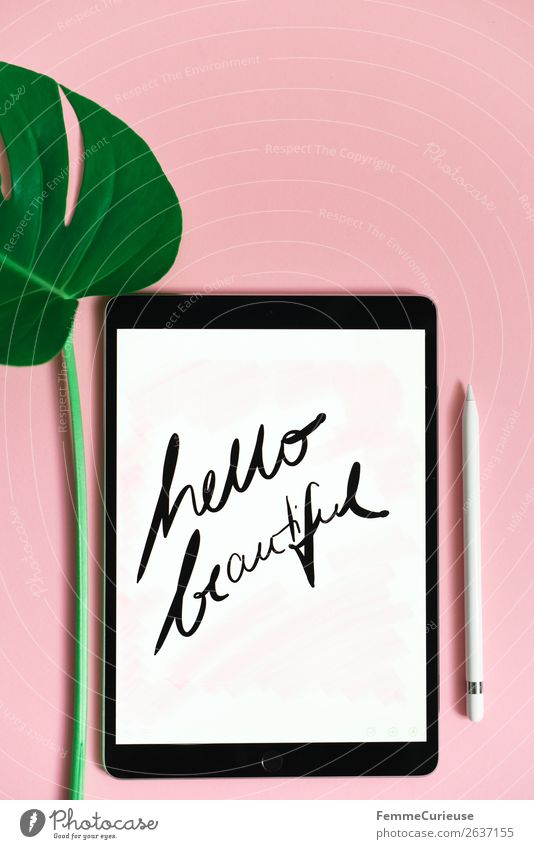 "Tablet with a handwritten ""hello beautiful"" on pink background Technology Entertainment electronics Advancement Future Sign Characters Communicate Creativity"