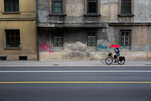 urban contrasts Cycling Bicycle Feminine Woman Adults 1 Human being 45 - 60 years Capital city Old town House (Residential Structure) Manmade structures Facade