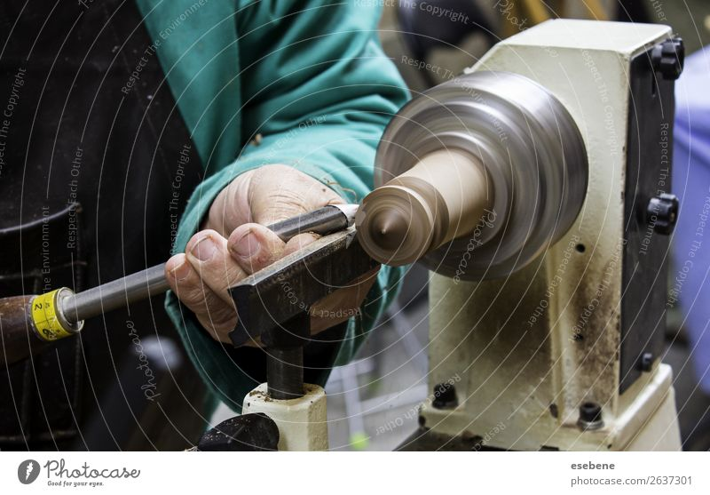 Man working with a wood lathe Design Work and employment Workplace Industry Craft (trade) Tool Technology Adults Hand Wood Metal Movement turning Carpenter