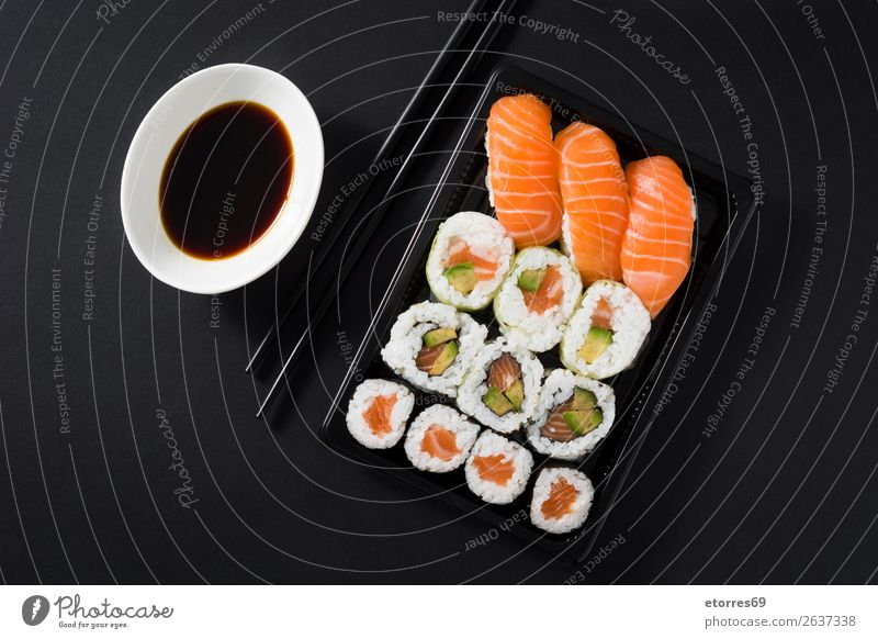 Japanese food: maki and nigiri sushi set on black background. Sushi Food Healthy Eating Food photograph Rice Fish Salmon Seafood Roll Meal Plate Gourmet Asia